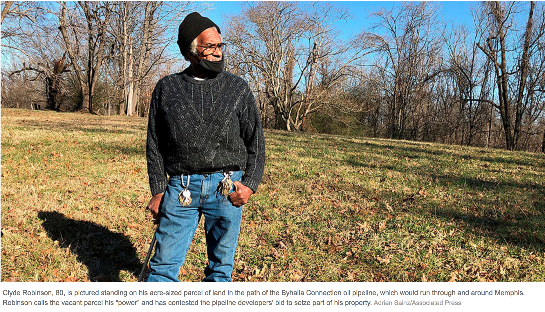 """Clyde Robinson, 80, is pictured standing on his acre-sized parcel of land in the path of the Byhalia Connection oil pipeline, which would run through and around Memphis. Robinson calls the vacant parcel his """"power"""" and has contested the pipeline developers' bid to seize part of his property. (Photo: Adrian Sainz/Associated Press)"""