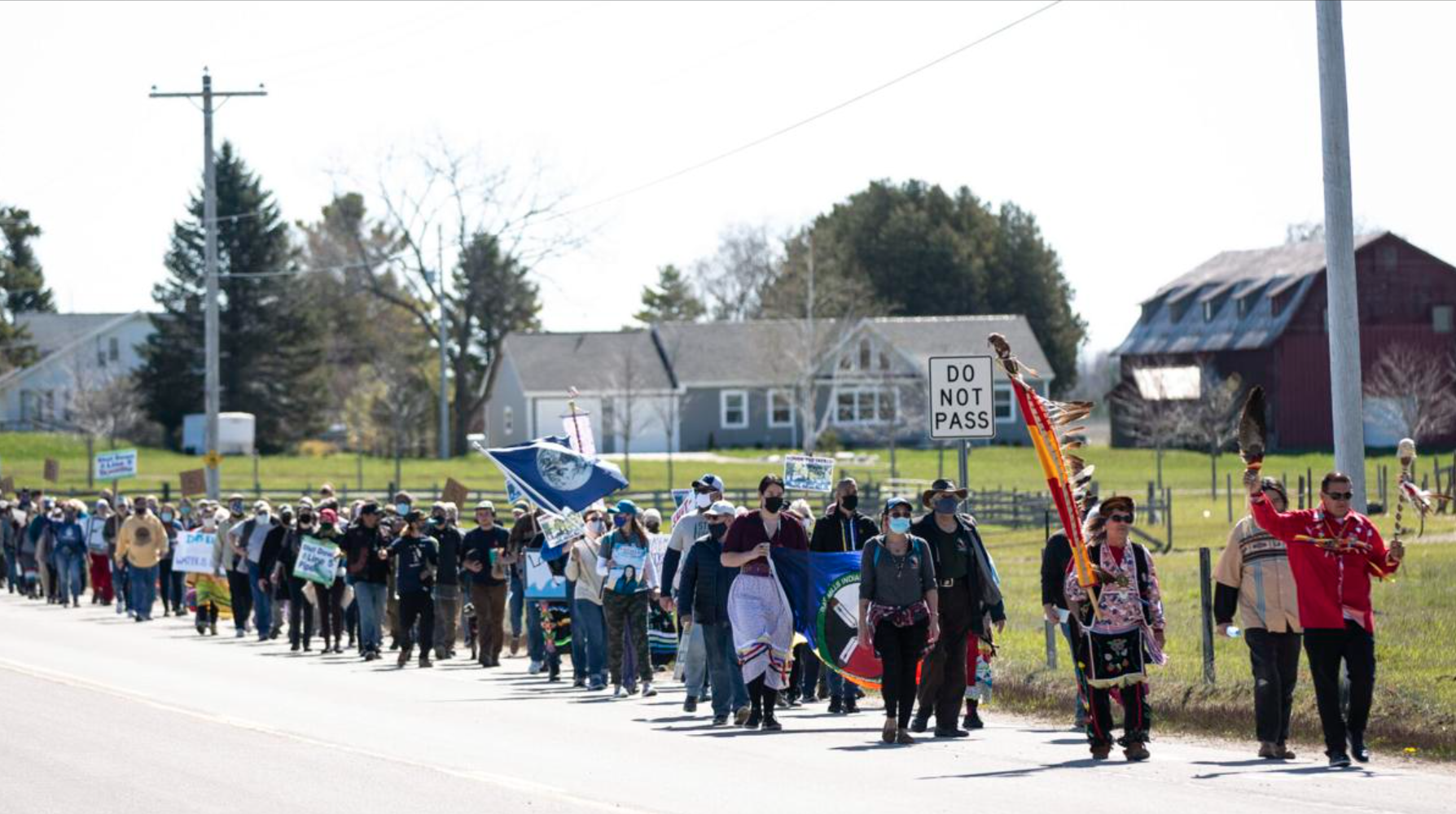 Protesters, led by indigenous elders, walk to Enbridge's Mackinaw Station in Mackinaw City. Protesters issued a symbolic eviction notice to Enbridge during the demonstration. Governor Gretchen Whitmer revoked an easement for the pipes to occupy the lake bottom in November and ordered the company to shutdown the pipeline by May 12. Enbridge has continued operating the pipeline saying that they will only stop operation if ordered by a court or regulator. (Photo: Mike Krebs / Record Eagle)