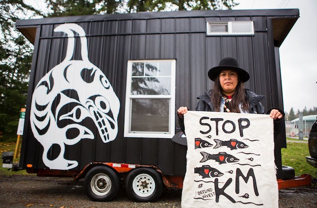 Kanahus Manuel of the Secwpemc First Nation and a Tiny House Warriors house (Photo: Katie Lin / Greenpeace)