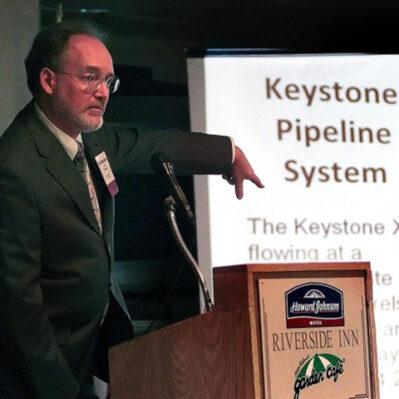 Photo of Paul Blackburn giving a presentation on Keystone Pipeline System.