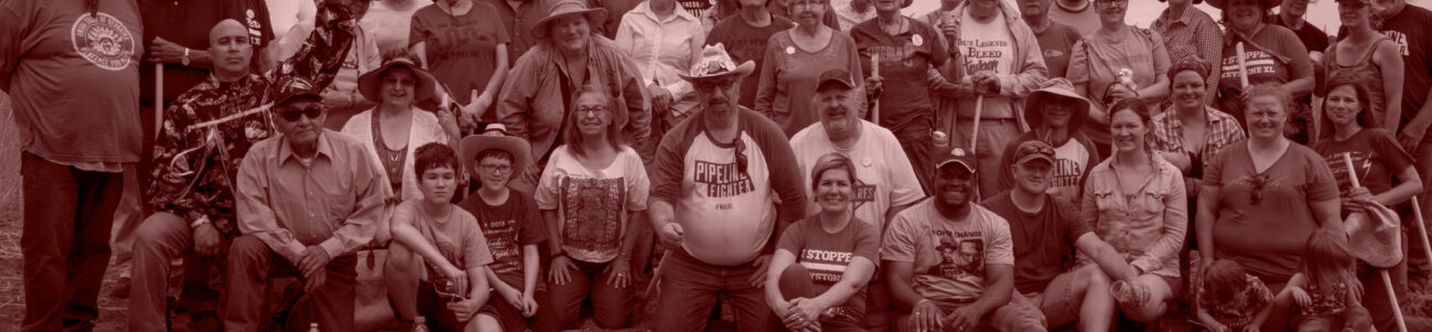 Group photo of smiling pipeline fighter activists.