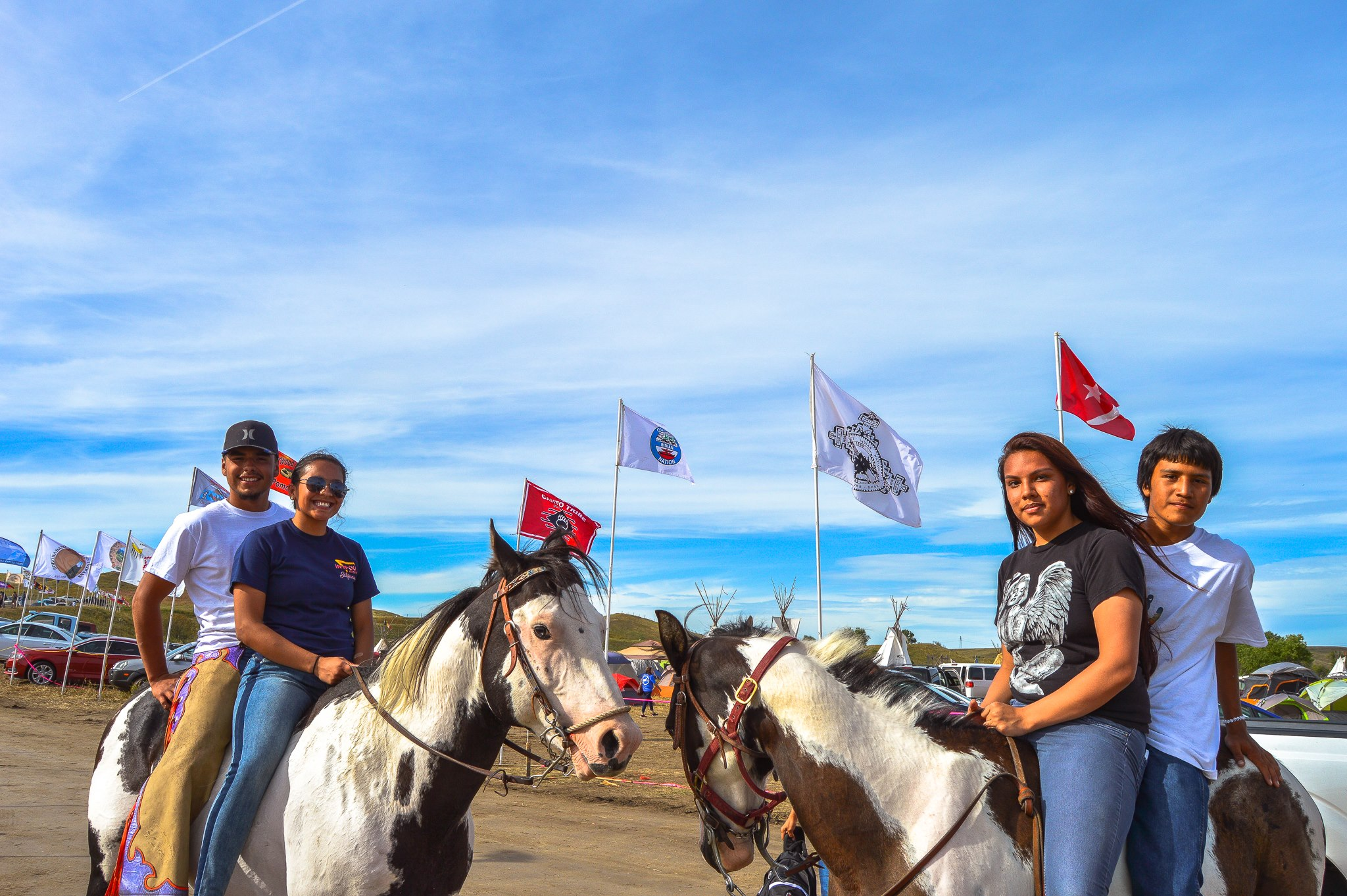 Young water protectors from Iowa made the trip to Sacred Stone Camp to stand with Standing Rock Sioux Tribe and all the people who oppose the Dakota Access Pipeline. Sept. 12, 2016. (Photo by Rob Wilson for Bold Alliance)