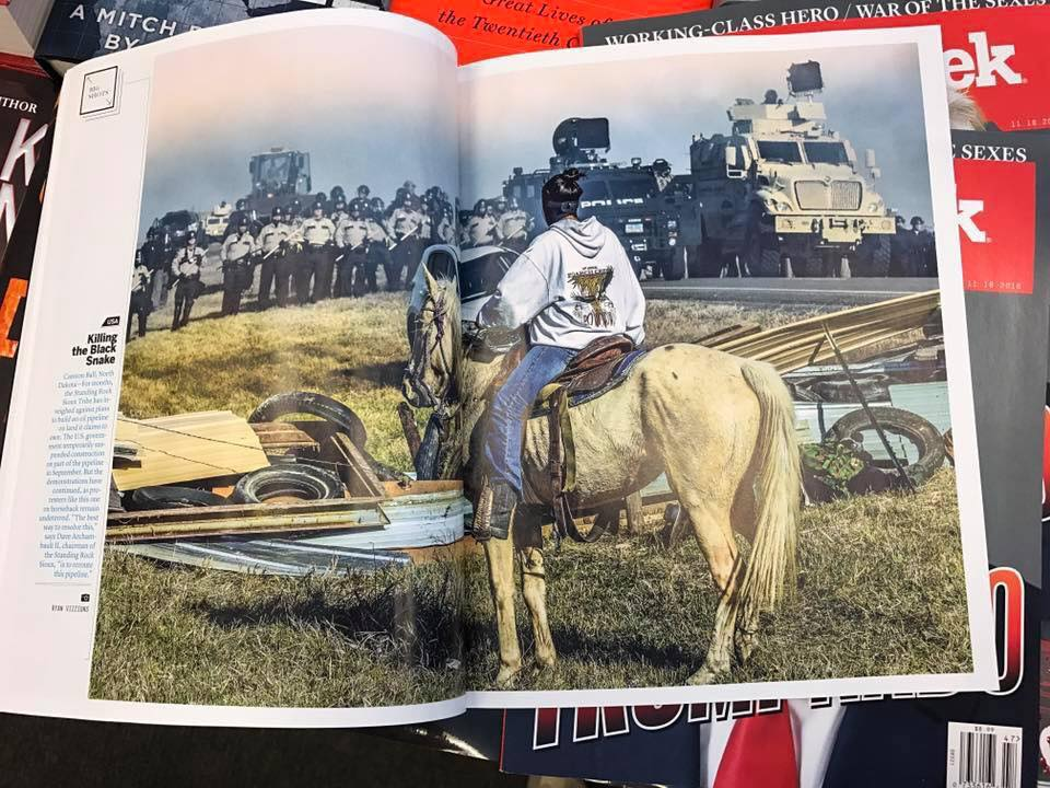 """""""Defend the Sacred: Killing the Black Snake"""" (Photo by Ryan Vizzions / No Spiritual Surrender, Standing Rock, 2016)"""
