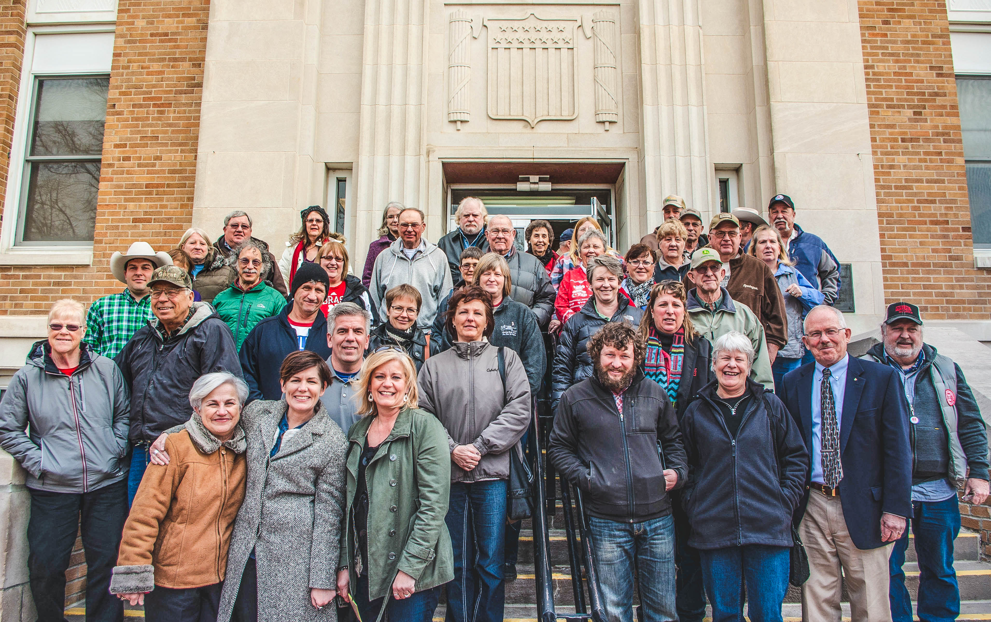 Pipeline fighters group photo in front of courthouse.